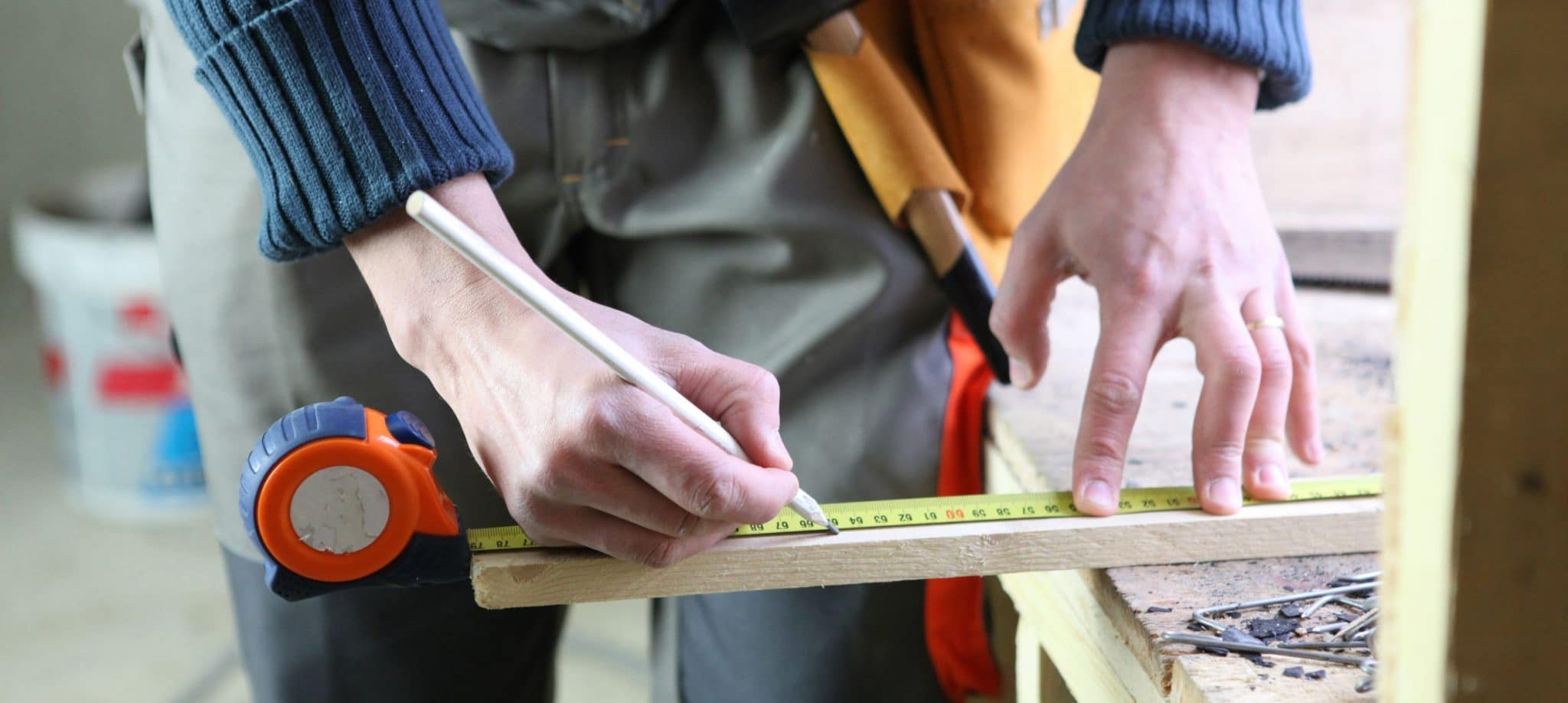 Man measuring a piece of wood